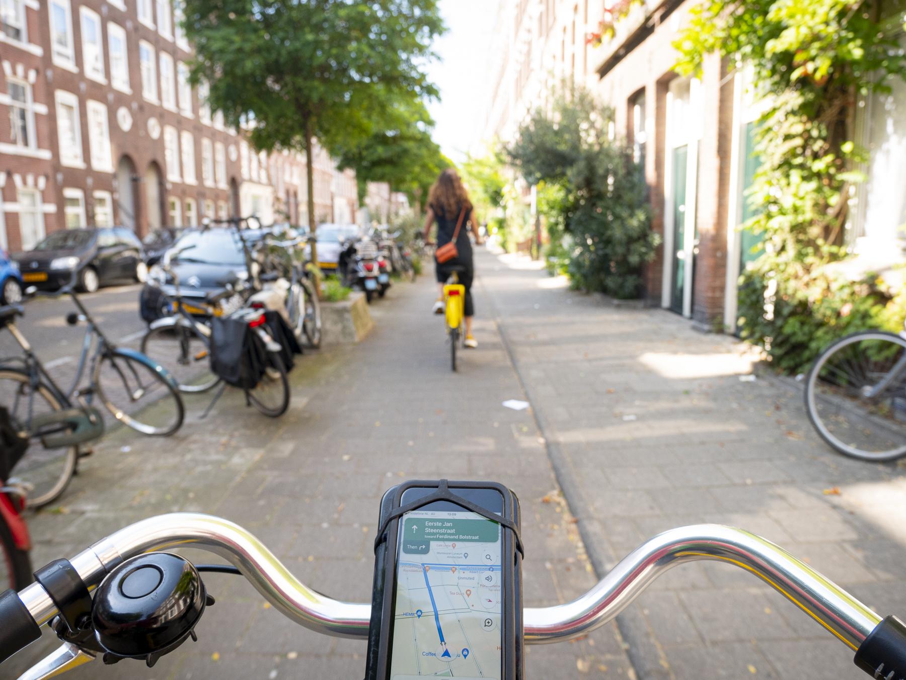 Jarred and Amanda Bike through Amsterdam